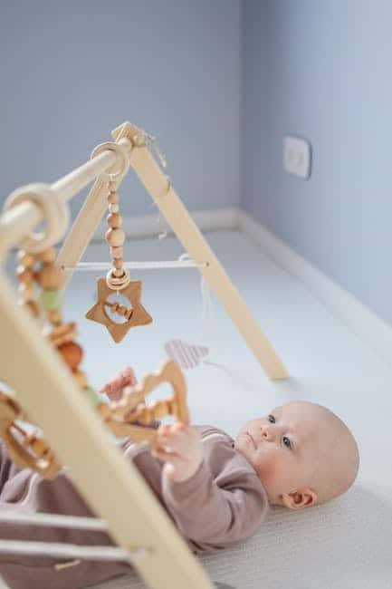 Baby and the hanging wooden toys