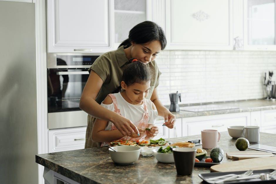 A boy is preparing food in a kitchen
