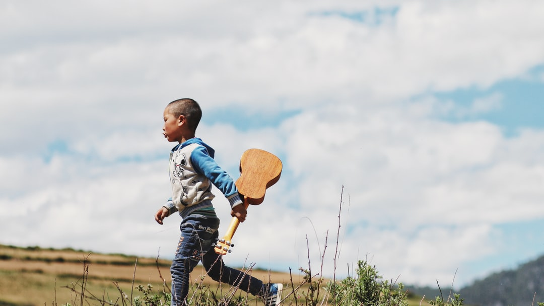 A young boy is flying a kite
